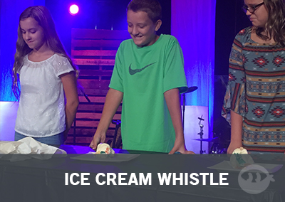 Students playing ice cream whistle - one of the many youth group games by Stuff You Can Use!