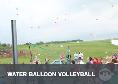 Water balloon volleyball - students having a ton of fun! A Stuff You Can Use outdoor water balloon youth group game.